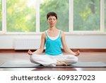 yoga and meditation indoors.... | Shutterstock . vector #609327023