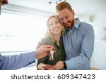 happy couple moving in a new... | Shutterstock . vector #609347423