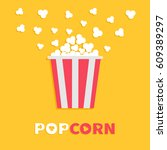 popcorn popping. red yellow... | Shutterstock .eps vector #609389297