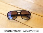 men's sunglasses at the wooden... | Shutterstock . vector #609390713