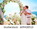 tropic beach  wedding | Shutterstock . vector #609428513