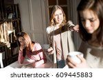 angry young woman holding... | Shutterstock . vector #609445883