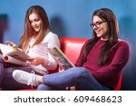 reading some magazines in the... | Shutterstock . vector #609468623