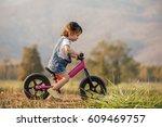 Happy Child Riding A Bike....