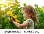 happy little girl smelling a... | Shutterstock . vector #609563147