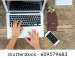 the woman is using laptop to... | Shutterstock . vector #609579683