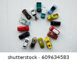 many multi colored toy cars on... | Shutterstock . vector #609634583