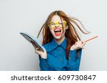 woman with a notepad screams...   Shutterstock . vector #609730847