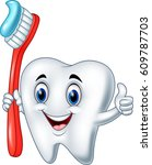 cartoon tooth holding a tooth... | Shutterstock .eps vector #609787703