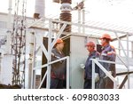 Three Electrical Workers...