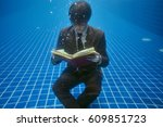 Young Man In Suit With Book An...