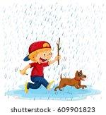 boy and dog running in rain...