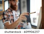human hand with paintbrush... | Shutterstock . vector #609906257