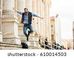 happy young man jumping up for... | Shutterstock . vector #610014503