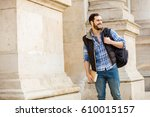 smiling student with books and... | Shutterstock . vector #610015157