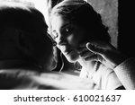 groom strokes bride's face
