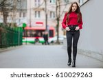 young woman walking on the... | Shutterstock . vector #610029263
