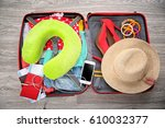open suitcase with different... | Shutterstock . vector #610032377