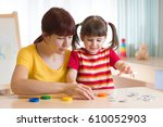 kid daughter and mother playing ... | Shutterstock . vector #610052903
