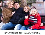smiling young family with two... | Shutterstock . vector #610075457