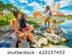 group of tourists sitting in... | Shutterstock . vector #610157453