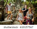 four tourists walking through... | Shutterstock . vector #610157567