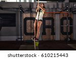 fitness rope climb cxercise in... | Shutterstock . vector #610215443