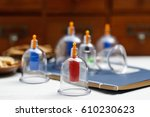 cupping therapy of traditional... | Shutterstock . vector #610230623