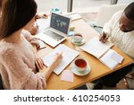 pleasant students workign on... | Shutterstock . vector #610254053