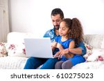 a young black father siting... | Shutterstock . vector #610275023