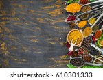 various spices spoons on stone... | Shutterstock . vector #610301333