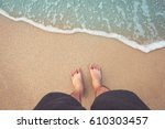 feet on sea sand and wave ... | Shutterstock . vector #610303457