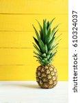 ripe pineapple on a white... | Shutterstock . vector #610324037