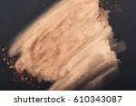Small photo of Golden Brush Strokes on black Surface