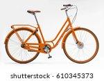 orange women city bike  | Shutterstock . vector #610345373