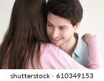 happy loving boyfriend embraces ... | Shutterstock . vector #610349153