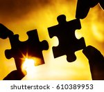 two hands trying to connect... | Shutterstock . vector #610389953