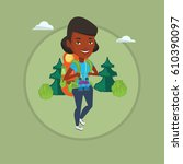 backpacker with backpack and... | Shutterstock .eps vector #610390097