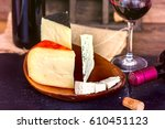 Red Wine And Cheese On Wooden...