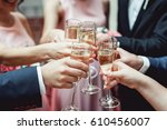 people hold in hands glasses... | Shutterstock . vector #610456007