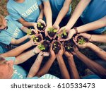 group of volunteer with sprout... | Shutterstock . vector #610533473