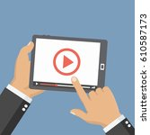 hands holding tablet with video ... | Shutterstock .eps vector #610587173