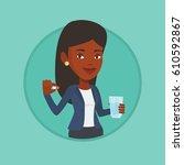 african woman taking pills.... | Shutterstock .eps vector #610592867