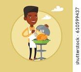 african american man cooking... | Shutterstock .eps vector #610599437