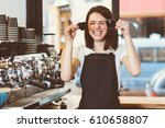 Female Barista Holding Two...