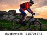 cyclist riding the mountain... | Shutterstock . vector #610706843
