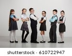 a group of children in uniforms ... | Shutterstock . vector #610722947