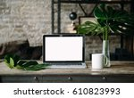 laptop mock up on wooden table... | Shutterstock . vector #610823993