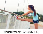 Sporty Young Woman Stretching...