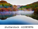 Stock photo autumn view of lake and mountain reflections in wedge pond 61085896